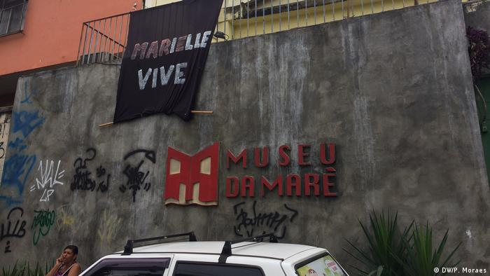 The external facade of the Museum of Mare in Rio de Janeiro. The sign reads: 'Marielle lives'