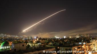A missile shoots across the Syrian sky
