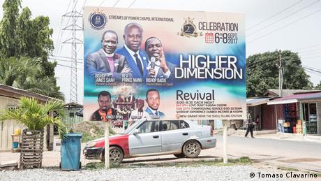 A billboard advertising a church and its pastors (Tomaso Clavarino)