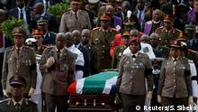 Winnie Madikizela-Mandela's coffin is taken from the Orlando stadium during her funeral service in Soweto, South Africa April 14, 2018. REUTERS/Siphiwe Sibeko