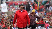 14.4.2018***Venezuela's President Nicolas Maduro and his wife Cilia Flores attend a rally with supporters in Caracas, Venezuela April 14, 2018. Miraflores Palace/Handout via REUTERS ATTENTION EDITORS - THIS PICTURE WAS PROVIDED BY A THIRD PARTY.