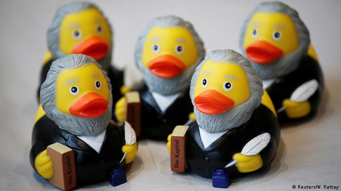Karl Marx as Rubber Ducky, with a copy of 'Das Kapital' in hand (Reuters/W. Rattay)