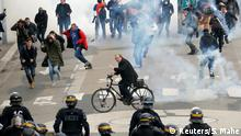 Tear gas floats in the air as protesters clash with French CRS riot police during a demonstration in Nantes, France, April 14, 2018. REUTERS/Stephane Mahe