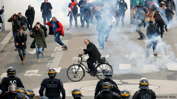 People protest in an anti-government demonstration in Nantes, France