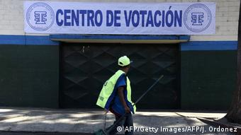 A municipal employee walks past a polling station ahead of a referendum on a border dispute with Belize in Guatemala City