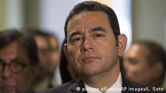 Guatemala's President Jimmy Morales listens as he gives a join press statement