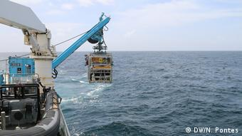 Remotely operated vehicle being lowered off the side of the Esperanza