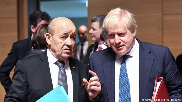 Le Drian and Boris Johnson talk at the start of the meeting in Luxembourg (Getty Images/AFP/E. Dunand)