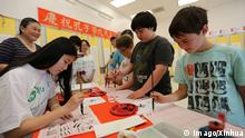Students learn Chinese calligraphy in the Confucius Institute of San Francisco State University in San Francisco Sept. 27, 2014. The Day of the Confucius Institute was celebrated worldwide on Sept. 27, marking the 10th anniversary of the founding of Confucius Institutes. ) (lyi) US-SAN FRANCISCO-CONFUCIUS INSTITUTE DAY-CELEBRATION LiuxYilin PUBLICATIONxNOTxINxCHN Students Learn Chinese Calligraphy in The Confucius Institute of San Francisco State University in San Francisco Sept 27 2014 The Day of The Confucius Institute what celebrated World Wide ON Sept 27 marking The 10th Anniversary of The Founding of Confucius Institute lyi U.S. San Francisco Confucius Institute Day Celebration PUBLICATIONxNOTxINxCHN