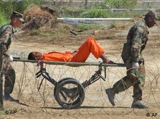 A detainee on a stretcher in Guantanamo prison camp
