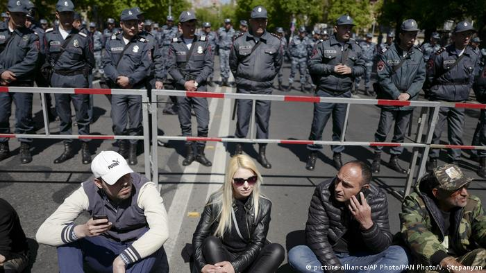 Police behind a barricade in Yerevan