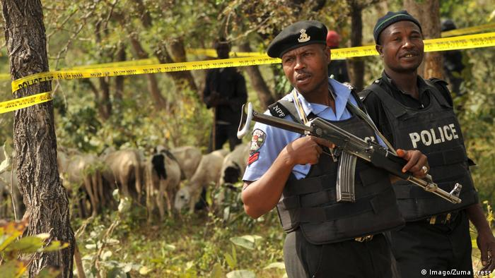 Policemen seen standing guard at Dajin Falgore of Doguwa local area during the handing over of the recovered cattles and sheeps from rustlers to the governor in Kano. Archive image from November 2, 2015. (Imago/Zuma Press)