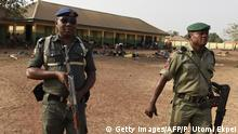 Policemen patrol at the internally displaced people camp occupied largely by women and children affected by herders and farmer's violent clashes from Logo and Guma communities at Gbajimba IDPs camp on the outskirts of Makurdi, capital of Benue State in northcentral Nigeria on January 3, 2018. Nomadic cattle herders have all but left Benue state, driven away by fighting over access to resources and a new law banning migratory herding, an age-old practice necessary for the survival of the livestock. More than 100 people have been killed since early January, with 100,000 fleeing their homes to safety, according to the local emergency management agency (SEMA). After months of inaction, the Nigerian army announced the imminent deployment of troops for Operation Cat Race in several city states, including Benue to end the violence. / AFP PHOTO / PIUS UTOMI EKPEI (Photo credit should read PIUS UTOMI EKPEI/AFP/Getty Images)