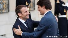 16.4.2018*** Canada's Prime Minister Justin Trudeau (R) is greeted by French President Emmanuel Macron (L) upon his arrival at the Elysee Palace in Paris, France, April 16, 2018. REUTERS/Charles Platiau