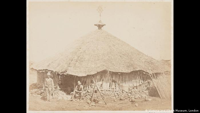 British soldiers stand infront of a hut in Ethiopia. (Victoria and Albert Museum, London)