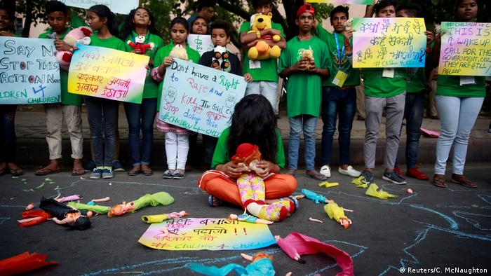 Children holding placards