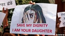Placard reading 'save my dignity I am your daughter' (Reuters/)