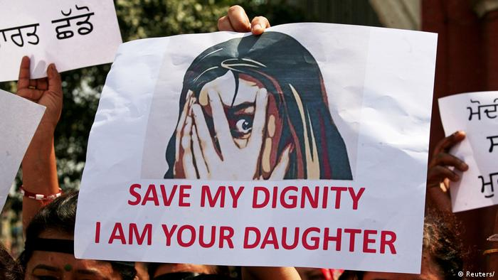 A poster with the words Save my dignity I am your daughter written on it during protests against rapes of girls in India.