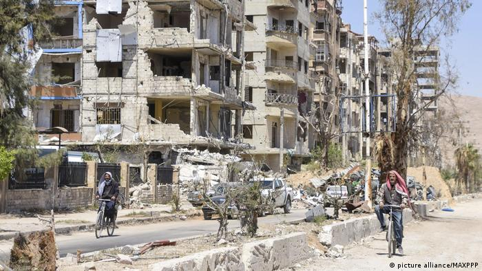 Bombed-out buildings in Douma
