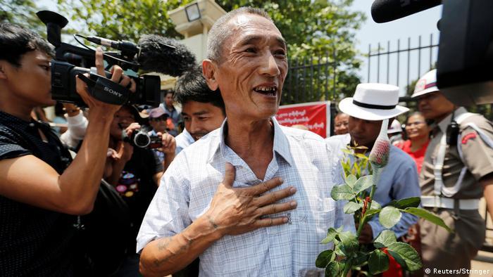 Newly-released prisoners walk out of Insein prison in Yangon, Myanmar