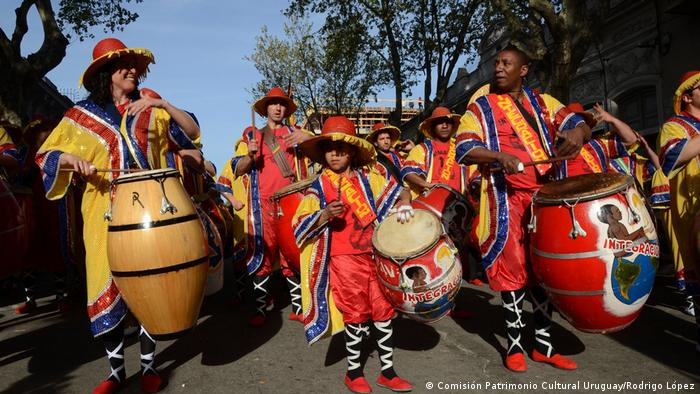 Candombe band in colorful traditional costumes in Uruguay
