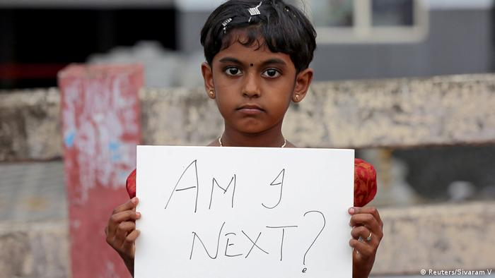 A young girl at a protest. (Reuters/Sivaram V)