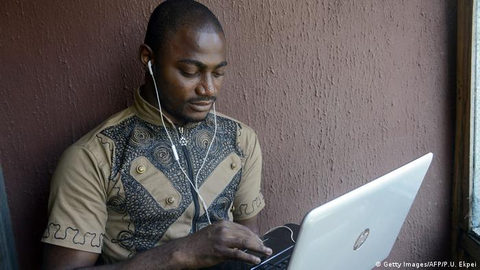 Nigerian student looking at laptop