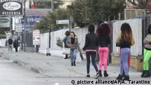 Nigerian prostitutes wait for clients in Castel Volturno, near Naples, Italy, Tuesday, Feb. 13, 2018. Nigerian teenagers and young women selling sex is a common sight for motorists in Italy. Working along roadsides and secondary highways in cities big and small, they are a haunting reminder that while Italy has been successful in curbing immigration from Libya, it has largely failed to help a fraction of the migrants trafficked as sex slaves. (AP Photo/Alessandra Tarantino)  
