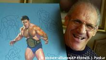 Former pro wrestler Bruno Sammartino poses with a painting of him in his pro wrestling prime weighing 275 pounds in 1965 at age 35.