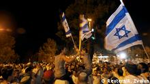 Israeli flags (Reuters/R. Zvulun)