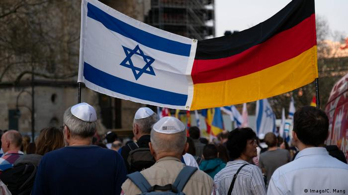 70 years of the State of Israel commemoration march with Israeli and German flags in Berlin