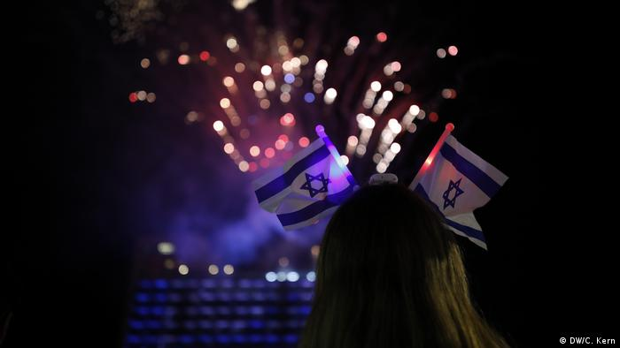 Israelis watch fireworks during celebrations marking Israel's 70th Independence Day at Rabin Square in Tel Aviv, Israel