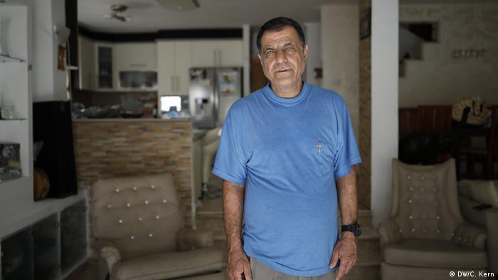 Portrait of Neri Ureli, 60, in his home in the Israeli settlement of Maale Adumim.