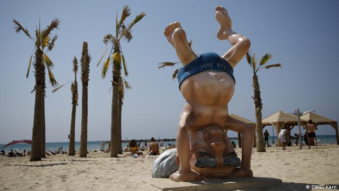 A statue of David Ben-Gurion doing a handstand is seen at Frishman beach in Tel Aviv, Israel. The statue was erected after a photograph of Ben-Gurion doing a handstand at the same spot in 1957.