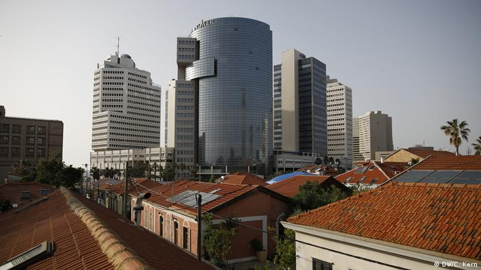 General view of Neve Tzedek with Tel Aviv's skyscrapers in the background