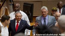 Cuba's President Raul Castro and First Vice-President Miguel Diaz-Canel arrive for a session of the National Assembly in Havana