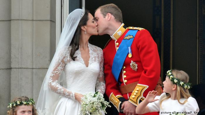 Prince William and Duchess Catherine kissing at the wedding ceremony.