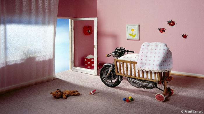 A baby's crib built into a motorcycle - photo by Frank Kunert