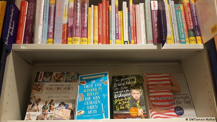 Pregnancy and parenting books on a shelf (DW/Tamsin Walker)