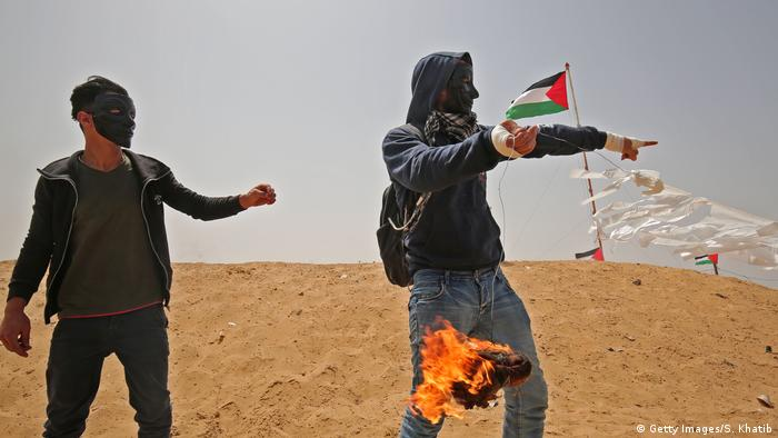 Palestinian protester prepares a kite with a firebomb (Getty Images/S. Khatib)