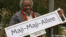A new street sign reads Maji-Maji-Allee (Tahir Della)