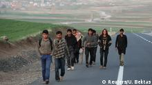 A group of Afghan migrants walk along a main road after crossing the Turkey-Iran border near Dogubayazit, Agri province, eastern Turkey, April 11, 2018. Picture taken April 11, 2018. REUTERS/Umit Bektas
