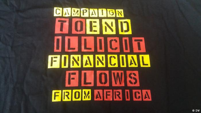 A campaign slogan on black material reads 'Campaign to end all illicit financial flows from Africa'