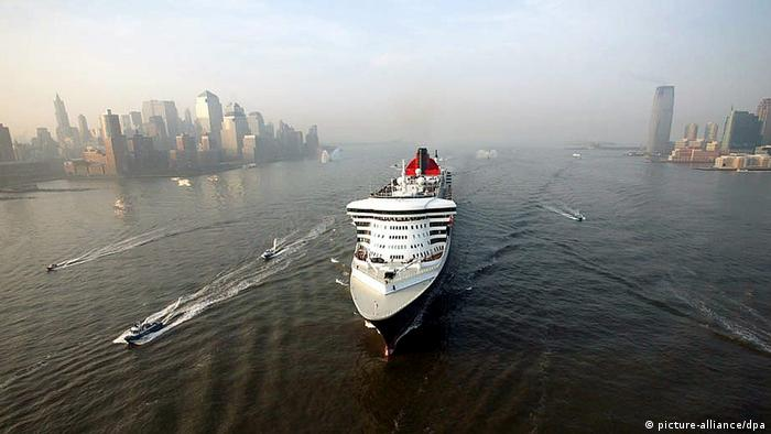 The cruise ship Queen Mary 2 sails up the Hudson River past the New Jersey shoreline and the lower manhattan skyline into New York City.