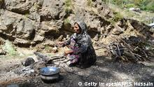 April 2018 +++ A Kashmiri Muslim Bakarwal nomad women prepares food at a temporary camp near Udhampur, some 72 kms north of Jammu, on April 18, 2018. Nationwide protests have been held in India over the gang-rape and murder of an eight-year-old Muslim girl in Jammu and Kashmir state. Police say the girl was raped and killed as part of an attempt by some of the village's majority Hindus to evict Bakarwal Muslim nomads, who graze their cattle in the hills in the summer months. / AFP PHOTO / SAJJAD HUSSAIN (Photo credit should read SAJJAD HUSSAIN/AFP/Getty Images)