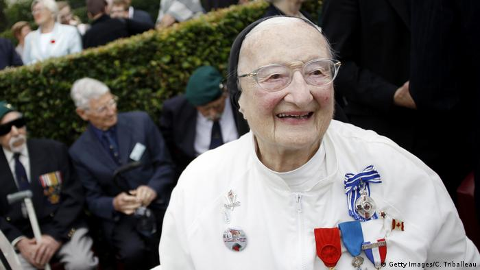 Sister Agnes-Marie Valois, with state medals pinned to her chest, takes part in the 70th anniversary of the Dieppe Raid in 2012.