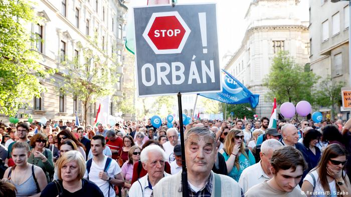 Demonstrator holding up a Stop Orban banner in Budapest