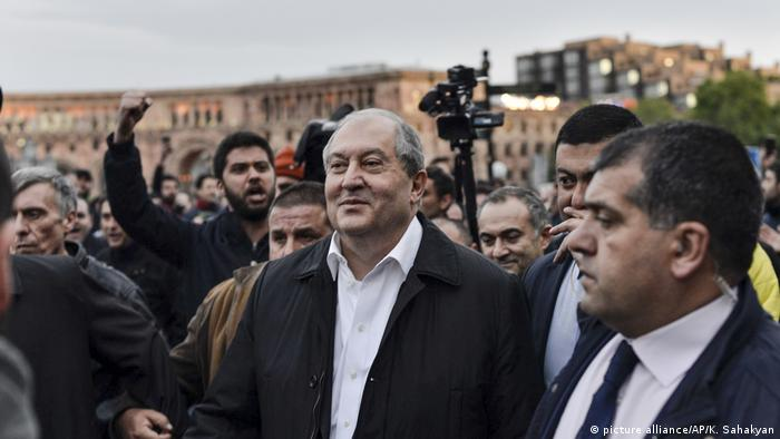Armenian President Armen Sarkissian stands in front of protesters in Armenia
