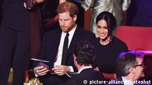 Prince Harry and Meghan Markle take their seats at the Royal Albert Hall in London to attend a star-studded concert to celebrate the Queen's 92nd birthday. The Queen and members of the royal family are guests of honour at the celebration, which is being billed as The QueenÕs Birthday Party.  