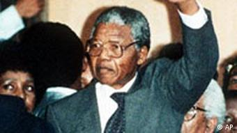 Nelson Mandela waving to a crowd upons his release from jail